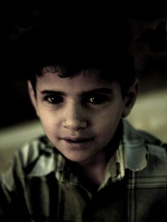 Boy in Aleppo, Syria..................... If you desire with all your heart, friendship with every race on earth, your thought, spiritual and positive, will spread; it will become the desire of others, growing stronger and stronger, until it reaches the minds of all men. Abdu' l Baha