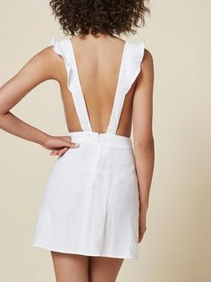 Who's a flirt? This is a slim fitting, mini length dress with ruffled straps that button in back.