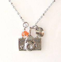 photographer necklace camera necklace photography, silver necklace, camera heart travel. $25.00, via Etsy.