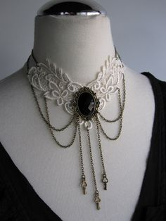 Brass and lace choker with beautiful black faceted cabochon focal.  An elegant  piece for the bride with a touch of goth and plenty of Victorian Steampunk charm.