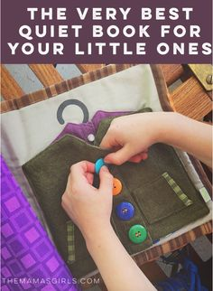 Buttoning the jacket. Love the coathanger. The Very best quiet book for your little ones