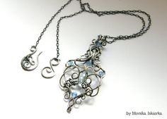 Erin wire wrapped pendant blue topaz Swarovski by MeaJewels