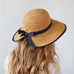 "With an adjustable inner band to assure a comfortable fit, this crocheted raffia hat is our pick for sun protection in the garden or on the beach.- Raffia, inner drawstring, grosgrain ribbon- Spot clean only- Imported25"" crown, 3.5"" brim"