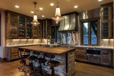 This great room designed by Etta Cowdrey and Mark Schriefer more than lives up to its name thanks to an open floor plan, designated dining and sitting areas, and rustic accents including beams and woodwork.