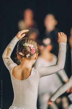 A little girl ballet dancer standing back while dancing by Jacek Jablonski