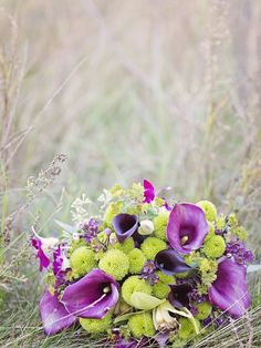 In love with this bouquet by Apple Blossom Flowers, shot by K. Thompson Photography. Purple and Green, such a bright and stunning combination!