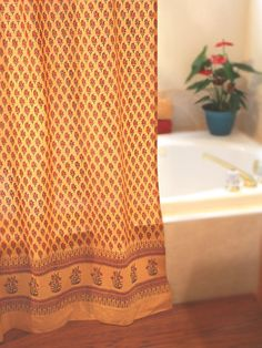 Orange Paisley Cotton Gypsy SHOWER CURTAIN: Warm, earthy mango hues combine with lush green to embrace sun kissed paisleys in this vibrant summer print. Accentuate this gentler shade of orange with dark wood toned accessories, like rattan mirrors, wooden towel racks and wicker hampers. Keep bath linens neutral and you will have a sunset colored bath that will stimulate and glow with personality.
