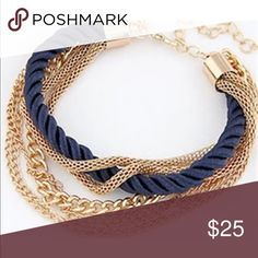 Blue and gold chain bracelet Gold Chain Layered Bracelet. Gold tone chain with blue color rope detail. Length is adjustable to all wrist sizes. Jewelry Bracelets