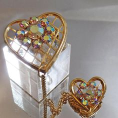 This  #vintage heart chatelaine brooch is gorgeous!!  It features a gold tone chatelaine style brooch with two hearts, one smaller, one larger, both with criss cross style m... #ecochic #etsy #jewelry #jewellery