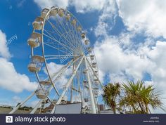 Download this stock image: A view of the Bournemouth Wheel located in the town square near the Pier - JGHYEA from Alamy's library of millions of high resolution stock photos, illustrations and vectors.