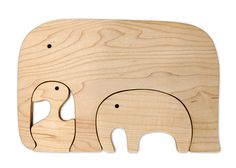 Google Image Result for http://madebyjoel.com/wp-content/uploads/2009/07/Made-by-Joel-Toys-1-Elephant-Puzzle.jpg