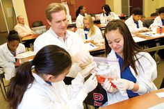 Frank Hardin, Ph.D., educational outreach manager, shows Ardmore Christian School students how to extract strawberry DNA.