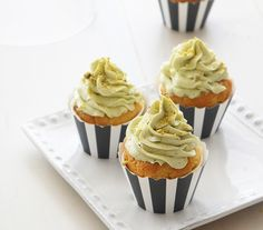 white chocolate butter based cupcakes with a no-cook meringue style buttercream made with ground pistachios