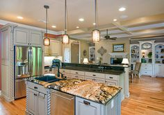 This kitchen island features beautiful marble counter-tops. Plan #1234-The Fincannon. http://www.dongardner.com/plan_details.aspx?pid=3746. #Kitchen #Marble #Island