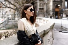 More on www.fashiioncarpet.com  Sunnies by H&M, Biker Leather Jacket by Oasis, Blouse by Isabel Marant, Boy Bag by Chanel, Leather Pants by H&M, Cut Out Sandals by H&M  #fashiioncarpet #ninaschwichtenberg