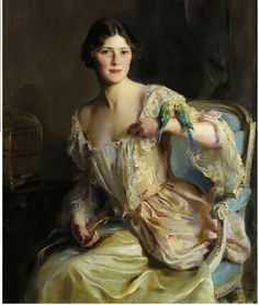 by Philip de László (Hungarian/British, 1869-1937).....who is this young woman, so proud of her Budgies???