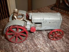 Antique Toy Cast Iron Arcade Farm Tractor McCormick Deering w Driver 10 20 | eBay    abt $150 (diff make)
