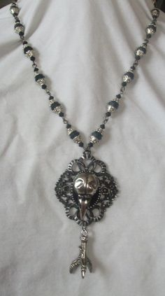 Raven skull and claw Gothic / Victorian cameo by MidnightDesires, $40.00