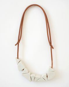 .by Jujumade, from California, whose accessories line is composed of hand-sculpted ceramic and leather elements.