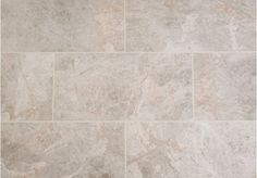 The Silver Shadow Honed Marble Tiles have a very light silver to grey background with darker quartz veining.