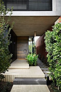 cantilevered stone steps with concrete accent / david watson architect