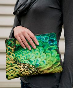 Peacock feather clutch