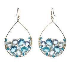 With blue gems ranging from sky blue to cerulean, these handcrafted teardrop earrings are a perfect colorful statement.