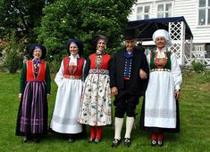 Bunads from Tysnes island in Hardanger. From left to right: Winter bunad, girl/unmarried womans bunad, feast bunad, man bunad and married womans bunad. Tysnesingen.no