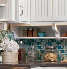 Merillat Classic® Open shelves under the wall cabinet are perfect for spices, small serving dishes or decorative items