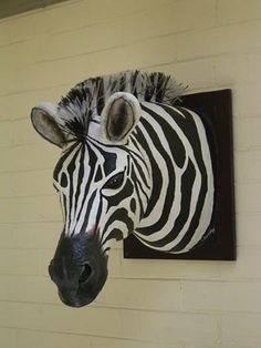 paper mache zebra head list=faux-taxidermy from CRIBCANDY - a gallery of hand picked houshold and interior design items from magazines and webogs, every day Paper Mache Projects, Paper Mache Crafts, Sculpture Projects, Art Projects, Paper Mache Paste, Paper Mache Clay, Paper Mache Sculpture, Animal Heads On Wall, Newspaper Art