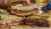 Layers of sauerkraut, corned beef, Swiss cheese, rye bread crumbs, and Russian-style salad dressing make up this casserole version of the deli sandwich .