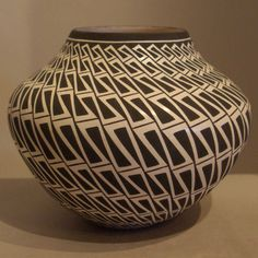 Pueblo:  Acoma  Artist:  Paula Estevan   Date Created: 2013  Dimensions:  4 3/4 in H by 6 in Dia   Item Number:  xxack3121  Price:  $ SOLD Description:  Water jar with geometric design New Arrival