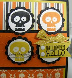 Shirley Sumption Stamp Sets: Halloween Hello 9 pc set Stampin' Up! Holiday Mini 2013 Ink and Paper Colors: Black, White, Summer Starfruit, Pumpkin Pie Accessories: White Bakers twine, Pumpkin Pie Button, Postage stamp punch, 1 inch circle punch, 1 1/4 scallop punch, Summer Starfruit ribbon, White Candy Dots Designer Series Paper: Witches' Brew Stampin' Up! Holiday Mini 2013 Big Shot: Pretty Print Textured Embossing Folder Stampin' Up! Holiday Mini 2013