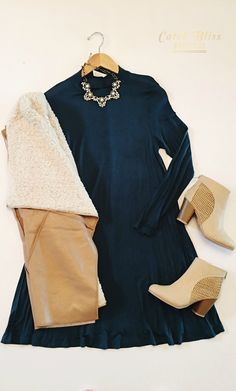 Winter Dress Outfit. Our Tori Dress in Teal is casually chic and on-trend this season. Come shop with us. Orders $50 and over receive free shipping! #winteroutfit