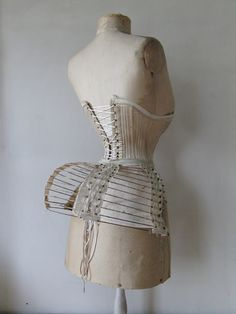Beautiful Bustle Cage of iron hoops and linen bands. 1870 (Actually, it looks rather comfortable. LC)