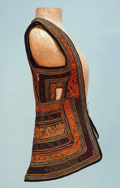 Turkish applioqué and embroidered vest, heavy cream wool decorated allover with burgundy, green and navy velvet bands embroidered in orange, green and blue accented with pink, metallic gold and tiny beads. Small size, probably for a child, early 20th c