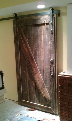 barndoor i made for a client s basement mancave, entertainment rec rooms, windows, Barndoor in a basement