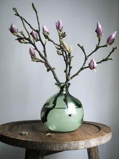 Love the magnolia in transparant vase arrangement...
