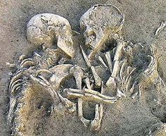 Archaeologists have unearthed two skeletons from the Neolithic period locked in an embrace and buried outside Mantua, Italy