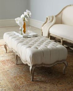 """Milania"" Tufted Ottoman at Horchow. Perhaps in the formal living room, a peanutbutter free zone."