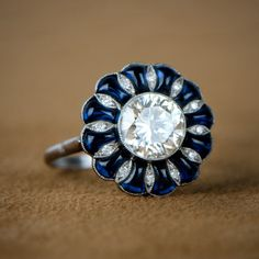 Diamond and Sapphire Cabochon Vintage Engagement Ring by EstateDiamondJewelry on Etsy https://www.etsy.com/listing/168977339/diamond-and-sapphire-cabochon-vintage