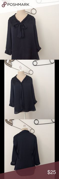 🆕 Banana Republic Mad Men navy neck-tie blouse Mad Men Collection for Banana Republic. This navy silky blouse is 1960s secretary chic with its neck tie bow and 3/4-length sleeves. 100% polyester. Machine wash or dry clean. Very good condition aside from mild fraying on right neck tie (see last photo). Collection no longer available online. Banana Republic Tops Blouses