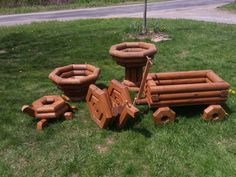 Tractor and wagon planters constructed of treated