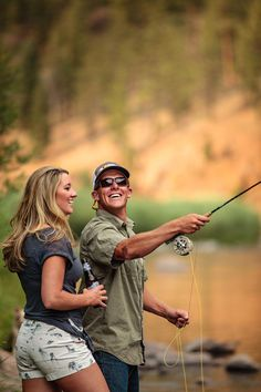 Fly Fishing Engagement Photos by Jason+Gina Wedding Photographers. This active couple love spending time together in the great outdoors.