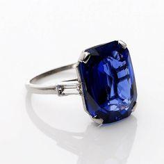 Cartier 14.55 Carat No Heat Sapphire Diamond Platinum Ring accompanied with Baguette-cut diamonds mounted in platinum. Circa 1920