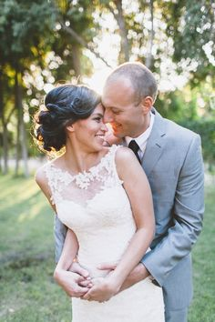 beautiful shot of bride and groom, I love the light and her exquisite illusion neckline wedding dress!