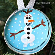 Learn how to make a fun mason jar lid ornament, Frozen style! Kids will make a fingerprint olaf character to give for christmas gifts.