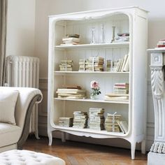 Empty the drawers from a dresser and us as a bookcase, paint and make shabby..