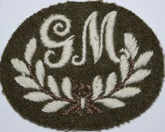This is an original British cloth arm badge of the unofficial RTR series of WW2 for Gunner Mechanic, all beginning with 'G'. There can be found G, GC, GD, GL, GM & GO badges. They refer to things like Layer, Mechanic, operator, Commander etc, but may stand for other things, no-one is really 100% sure, but they were worn.   eBay! British Army, Gd, World War Ii, Badges, Arms, Germany, Ebay, World War Two, Badge