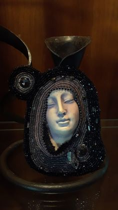 This is a stunning piece of work by Martha Bishop. I absolutely love the drama of the darker beads against the white face. Thank you Martha for sharing your creativity with us!